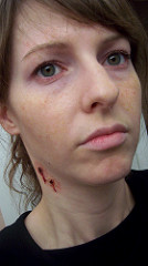 Woman with vampire bite makeup