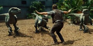 Chris Pratt's Owen Grady holds a pack of velociraptors at baywith nothing but his body language.