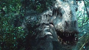 An image of Indominus Rex coming out of the forest.