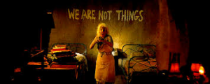 """Image from Mad Max of graffiti reading """"We Are Not Things"""""""